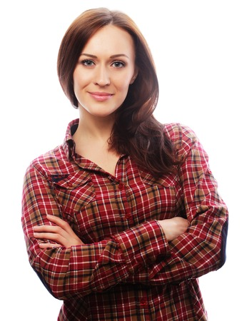 young brunette woman in shirt over white background photo