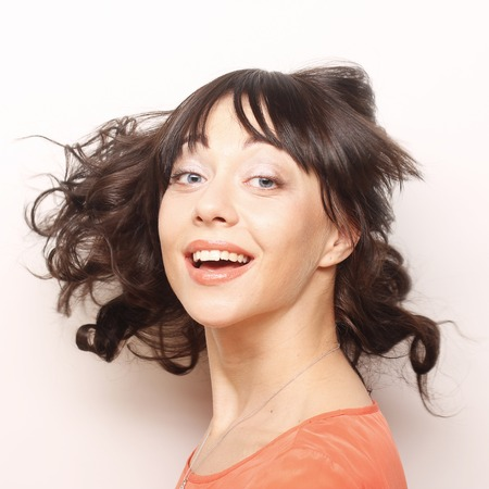 dishevel: Young happy woman with wind in hair