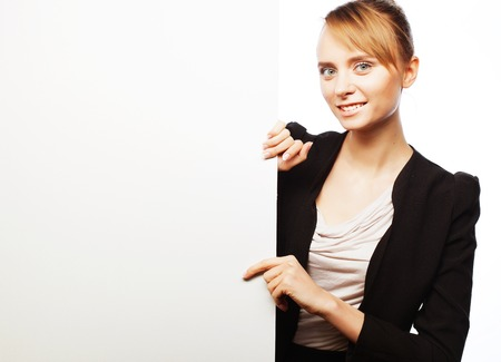 signboard: Happy smiling young business woman showing blank signboard, over white  background