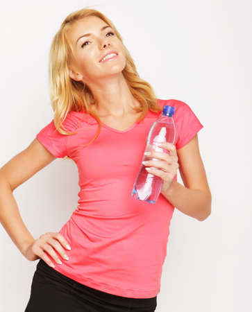 excercise: sport, excercise and healthcare - sporty blond woman with water bottle Stock Photo