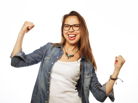 Portrait of happy excited woman celebrating her success. 免版税图像