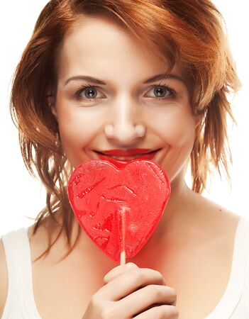 lolly pop: Pretty young woman holding lolly pop Stock Photo