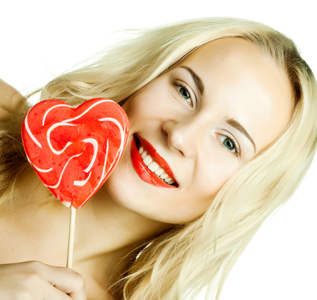 lolly pop: young beautiful woman with heart lolly pop