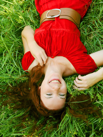 lays: beautiful girl lays on a grass Stock Photo