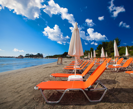 travel concept - sunchairs with  umbrellas on beautiful  beach, Zakynthos  island, Greece Stock Photo