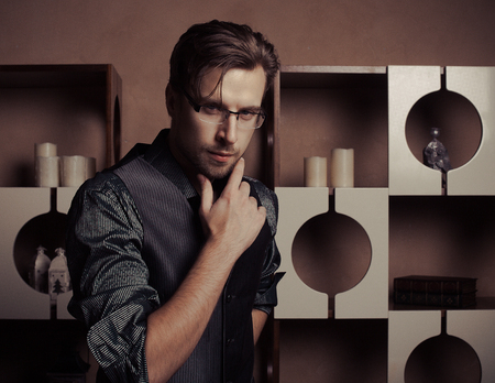 glasses model: Fashion young man in luxury modern interior Stock Photo