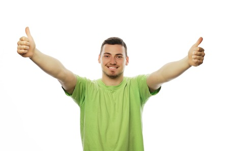 legs folded: life style  and people concept: casual young man in shirt  with both hands raised in the air. Winner and happy. Stock Photo