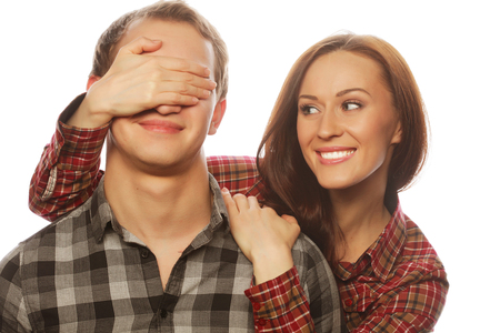 eyes closing: Couple in love. Young woman closing his boyfriend eyes. Stock Photo