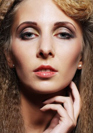 glamourous: Glamourous woman face with fashion make-up.
