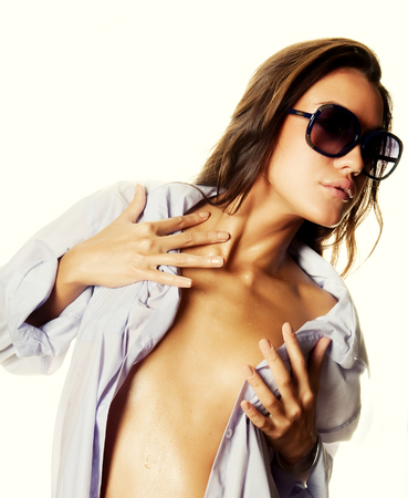wet woman: Wet woman in white shirt and sunglasses isolated on white