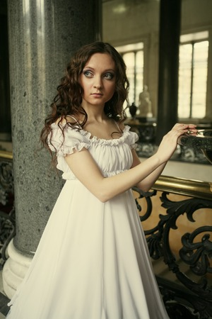 victorian lady: Portrait of a beautiful young victorian lady in white dress Stock Photo