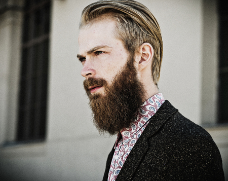 male fashion: Portrait of young beautiful fashionable man outdoor