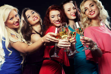 flutes: Group of partying girls clinking flutes with sparkling wine