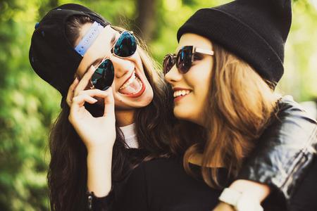 cute girl smiling: Teenage girls, having fun outdoor. Happy summer time.