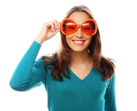funny face: Party image. Playful young woman with big party glasses. Ready for good time Stock Photo