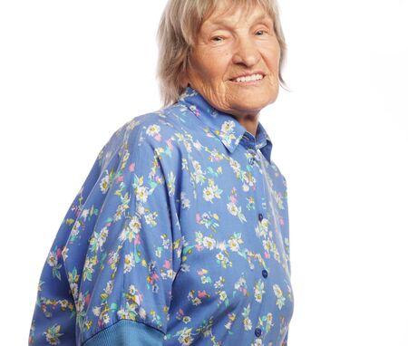 80 90: Happy senior woman isolated on white