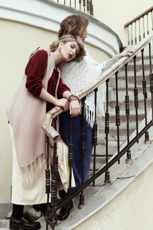 two persons only: photo of a two beautiful women posing on a stairs