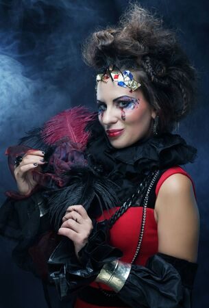 halloween symbol: Young woman with creative make up. Halloween theme. Stock Photo