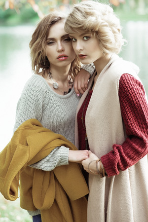 2 persons only: Young beautiful women near lake. Glamour fashion portrait. Stock Photo