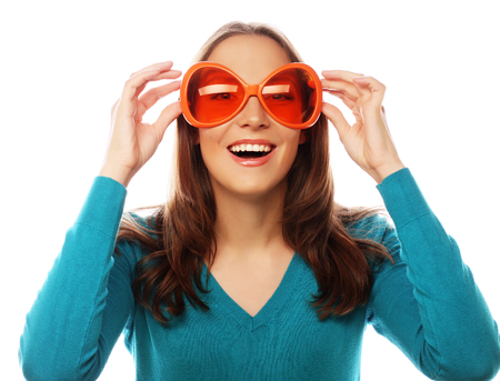 girl face close up: Party image. Playful young woman with big party glasses. Ready for good time Stock Photo