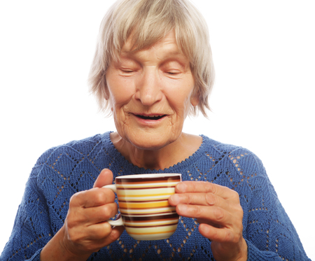 80 90: Happy old lady with coffee, isolated on white