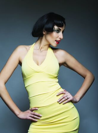 voile: Beautyful woman in vintage style. Black hair and yellow dress.