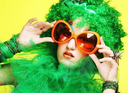 carnaval: Happy young  woman with green hair and carnaval glasses Stock Photo