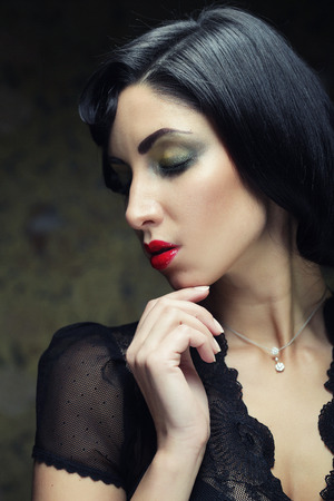 coloring lips: Fashion woman portrait. Vogue Style. Beauty girl with black hair.