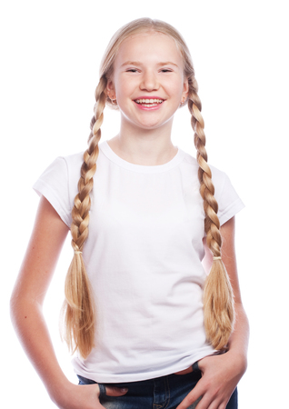 braids: Portrait of a beautiful European blonde girl with braids. Smiling girl. Studio shot, isolated on white background. Stock Photo