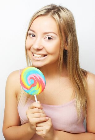 sugarplum: Beautiful young woman with big colorful lollipop. Stock Photo