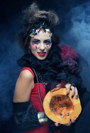 pumkin: Dark With with pumkin over dark background. Halloween theme.