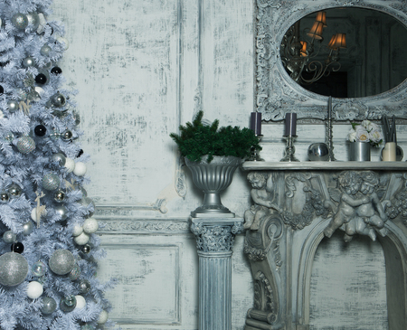 hearthside: Christmas living room with tree. Blue toned. Happy Holiday. Stock Photo