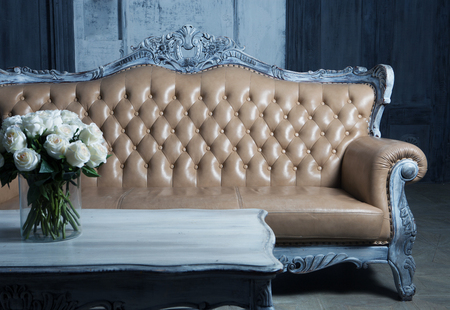 styled: Old Styled Interior, blue tones: sofa and roses Stock Photo