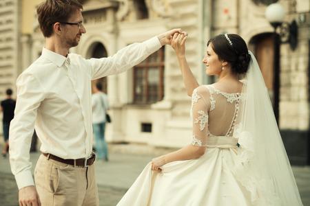 matrimonio feliz: caucasian happy romantic young couple celebrating their marriage