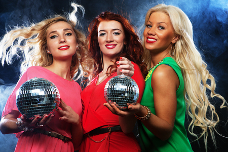 partying: Group of partying girls  with disco ball, happy and smile Stock Photo