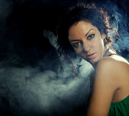 decolletage: young beautiful woman in green dress