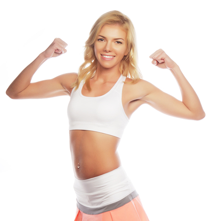boast: sporty woman is showing her strong hands on white background
