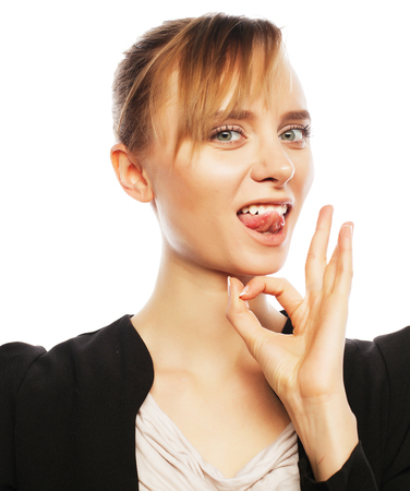a ok: Happy smiling cheerful young business woman with okay gesture, over white background