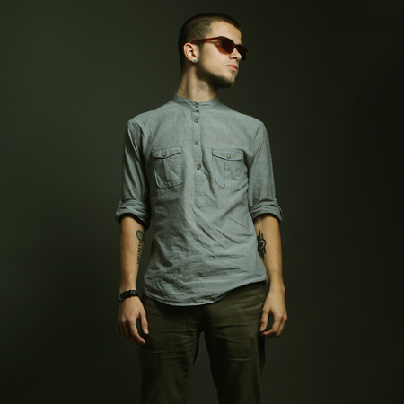 abdominal wall: Handsome man with sunglasses. Studio shot.