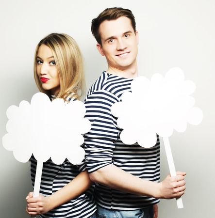 amorous: couple, love and family concept: amorous couple holding blank paper on stick.