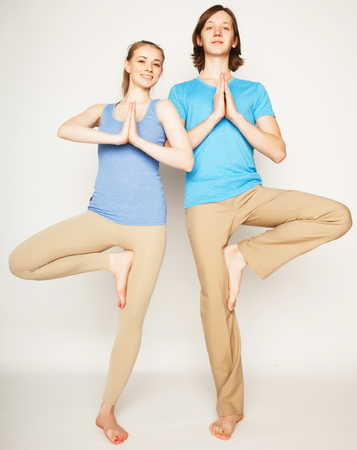 two stroke: Young couple in yoga pose, happy family