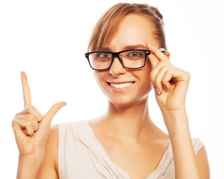 business products: woman wearing glasses pointing up isolated on white