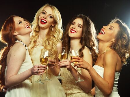 clinking: Group of partying girls clinking flutes with sparkling wine