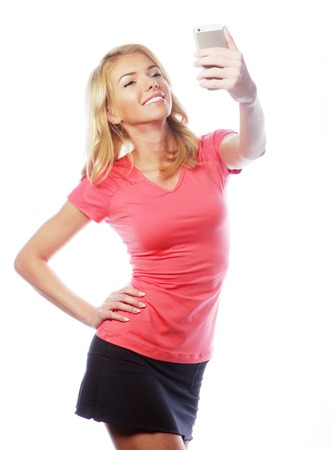 tumb: sporty blond woman making selfie, studio shot Stock Photo