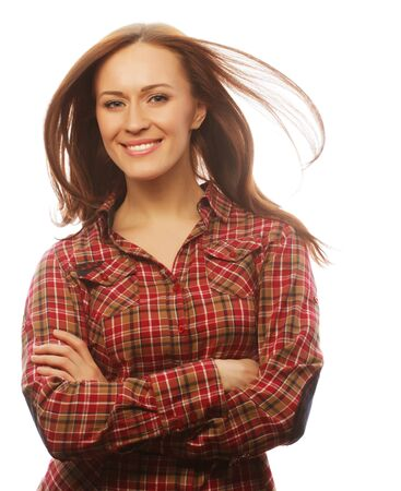 20 24 years: young brunette woman in shirt over white background