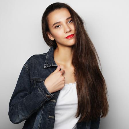 beauty girls: Beautiful young happy woman. Studio shot. Stock Photo