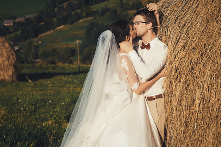 hayloft: Beautiful wedding in the mountains, a young happy couple near the hayloft.