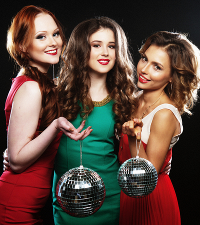 party friends: Party girls with disco ball, happy and smile. Stock Photo