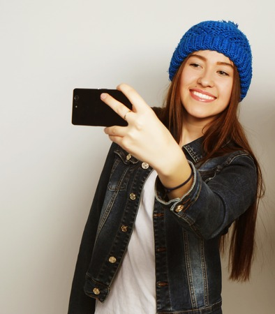 self   portrait: Girl take a self portrait with her smart phone