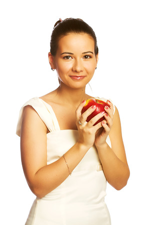 dietetical: Pretty young smiling woman with red apple.